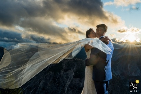 Glacier Point wedding portraits - Veil blowing in the wind at sunrise.