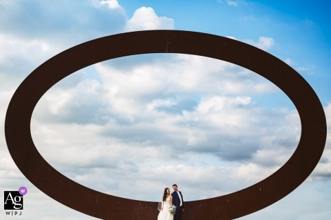 Wedding pictures in Tuscany on the way from ceremony to the venue | Couple standing in front of the ring with clouds