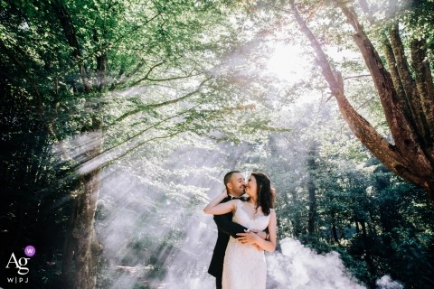 Kıyıköy Smoke and Love wedding portrait in the sunshine and trees with the bride and groom