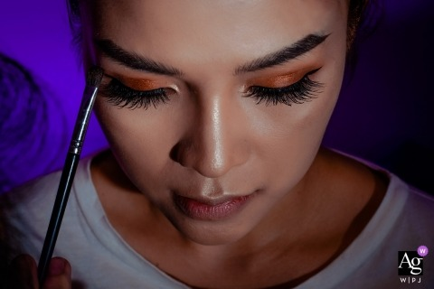Vietnam White Palace Wedding Venue Photographer: 	This shot was captures when bride was on makeup with a purple gel lighting at background.