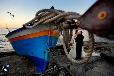 Scaro alaggio, Chianalea di Scilla, Calabria wedding pictures. 	A portrait of the newlyweds