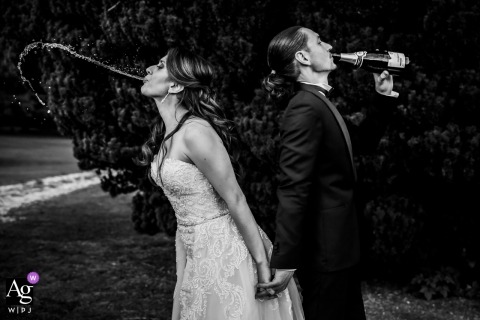 Wedding Reception venue photography - France | Bride and groom with Champagne