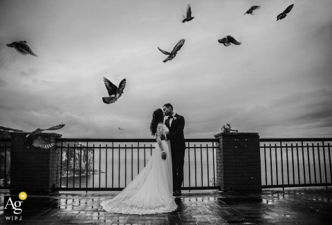 Campania Outside wedding portraits - Couple session overlooking the water with birds flying overhead