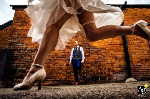 England Private farm wedding photos | The bride leaps over her new husband