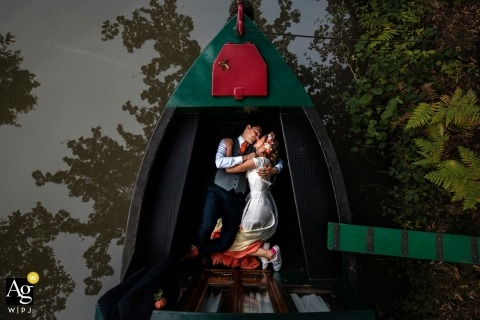Basingstoke Canal Wedding Portrait - Couple snuggle up in the bottom of a canal boat