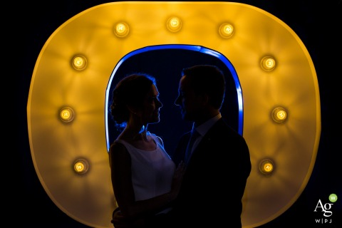 Wedding Photography at Venue in Ponferrada, Spain | Portrait of a couple's silhouettes with a big light letter