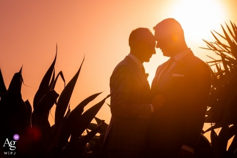 Santa Monica Promenade, Los Angeles CA | Two grooms embrace at sunset.
