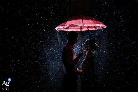 Fujian, China Wedding Day Portrait in the Rain with Red Umbrella at Night