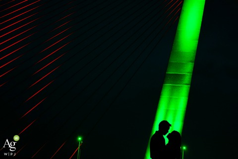 This picture of the bride and groom under a green light was taken at da nang