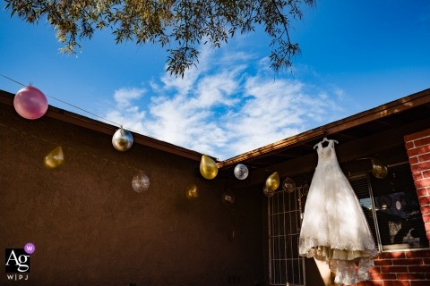 Southern California Home Wedding Photo | Detail of the Dress Hanging Outside