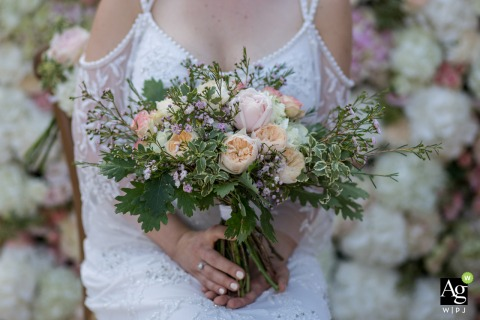 "Wedding Reception and ceremony venue photos from ""La Menuse"" in Dordogne - Bride bouquet on floral wall"