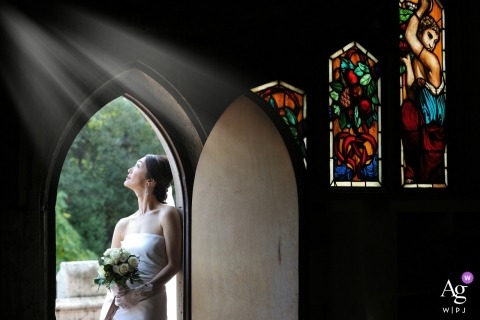 Tuscany Bride at the Church Looking to the light during a Wedding Portrait