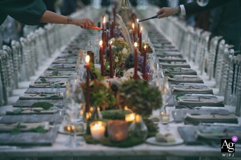 Tuscany Wedding Reception venue photography showing the Lighting of the table candles