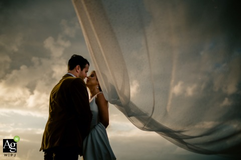Fort Zachary Taylor, Key West, Florida wedding photographer said: Wind was blow 20 knots across the entire island. So that allowed me to use it to my advantage and just let the brides veil fly
