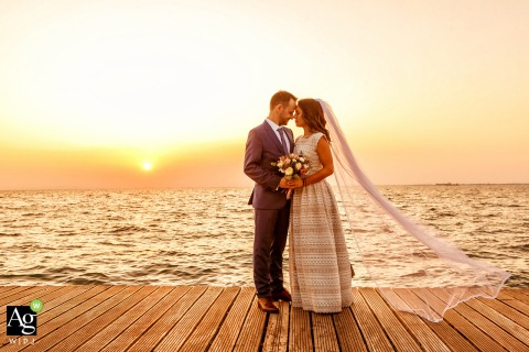 Greece wedding photographer working in Thessaloniki | Couple portrait on the boardwalk / dock at sunset