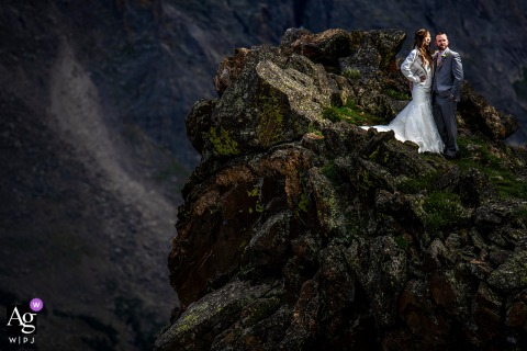 Wedding Portraits at Rocky Mountain National Park (Estes Park, CO) | Bride and groom on rock formation