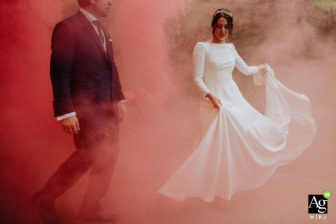 Baserri Maitea, Bizkaia, Spain wedding venue photography. A portrait of the bride and groom in a thick smoke bomb