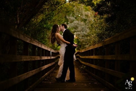 Key West, Florida Nature Preserve wedding photographer: Use of a faster shutter speed to darken the light, which created the portrait. the light was coming through one hole of the canopy, so I placed them there and was able to create a natural vignetting
