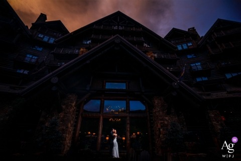 Ritz-Carlton Bachelor Gulch | Photo of couple Standing in front of the Ritz during an epic sunset.