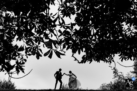 Flanders Portrait of the Bride and Groom Dancing under big Trees