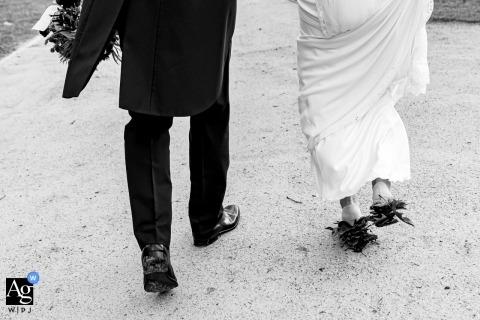 Flanders Wedding Day Detail Shot | Bride and groom walking away from the camera...showing feet and legs