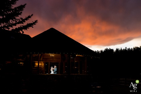 Evergreen Lakehouse wedding venue picture | Couple dancing in pavillion under sunset sky