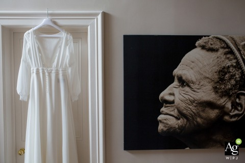 Bristol England wedding photographer working at the Bride's home in Bath | Wedding dress hanging detail photo