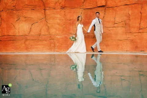 Hilton Vilamoura wedding venue photography of the bride and groom walking and the Pool reflection