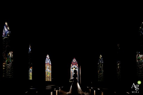 Haras Albar, Campinas wedding photographer | A dark portrait of the bride's silhouette with the help of stained glass
