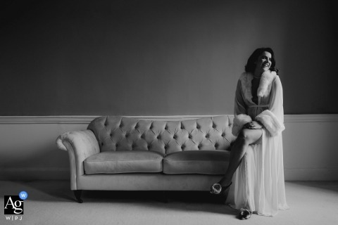 Four Seasons, Hampshire Wedding Portraits | The Bride sitting on arm chair in dressing gown