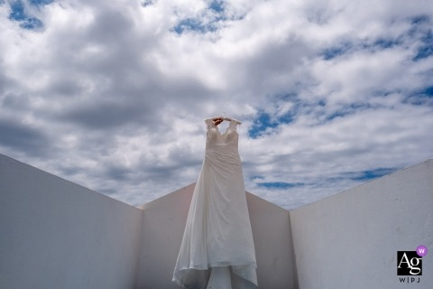Portugal home photographer: the bride ask me to choose a place to hang the bride dress and i put it against the sky