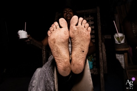 Reception Venue Photo from Brazil | The Bride showing her dirty feet after party.