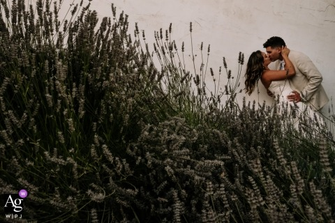 Hacienda de Leal, San Juan Bautista, California Bride and groom on wedding day at a lavender garden for portraits