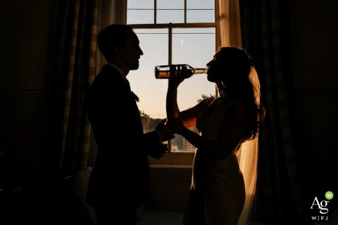 Peter and Paul Hotel, New Orleans wedding venue photo. Newlywed portrait drinking bourbon to calm the nerves