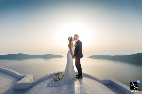 Andromeda Villas Santorini sunset portrait session with the bride and groom overlooking the water