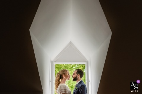 Palacio de Silvela Couple framed in the doorway | Wedding portrait of bride and groom