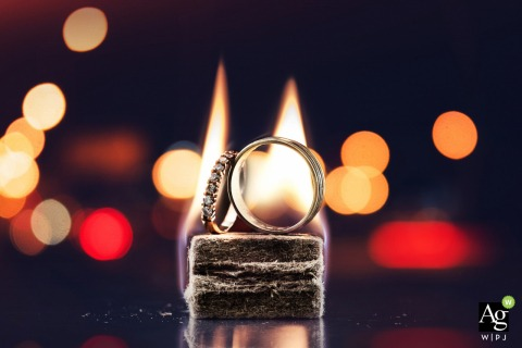 Miami Florida Wedding Photographer Said: During he party at the reception house I took this photo of weddings rings with a quick light BBQ and light of cars in the parking lot.