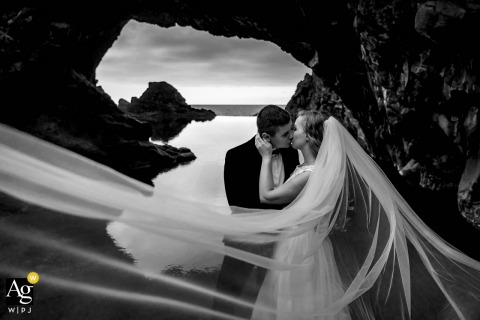 Local natural lava pools wedding portrait | The couple was taken for photos close to a set of natural lava pools.