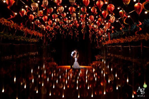 Ho Chi Minh Reception Venue portrait photo of love | Wedding couple photography in red with lights