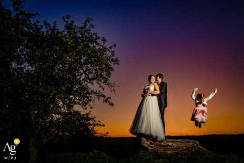 Germany Ravensburg Sunset portrait of the couple with flower girl