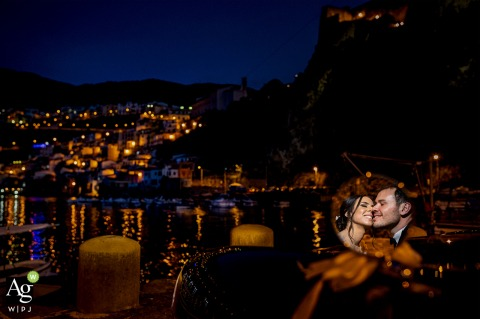 reggio calabria reflexes | bride and groom portrait on wedding day with the city lights at night and a mirror for reflection