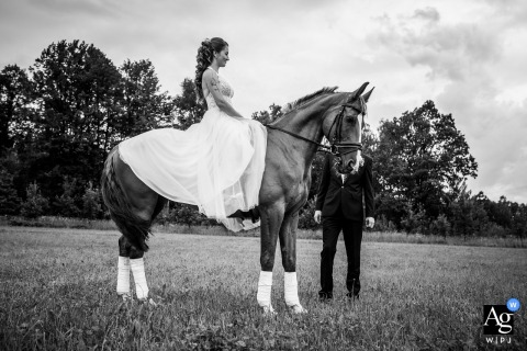 Pelhrimov classical horseback portrait of the bride and groom in black and white
