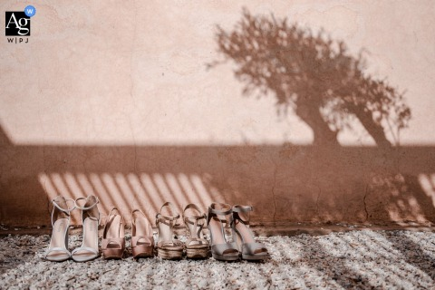 Taj Omayma, Ceremony location, Marrakech photo of the wedding shoes in the shadow of olive trees