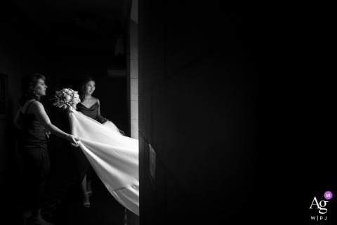 Victoria-AU photography | Bridesmaid helps bride to pick up her dress