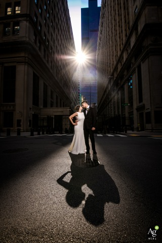 board of trade chicago bride and groom portraits | OCF lit photography on wedding day in the streets with tall buildings and the direct sun