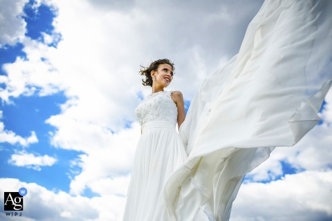 Chicago Illinois bride portrait against the blue sky with clouds