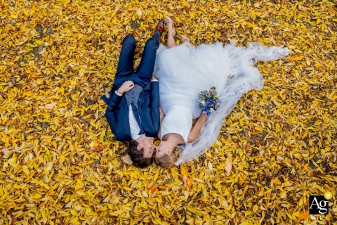 Utrecht Creative Portrait of wedding couple on a blanket of autumn leaves