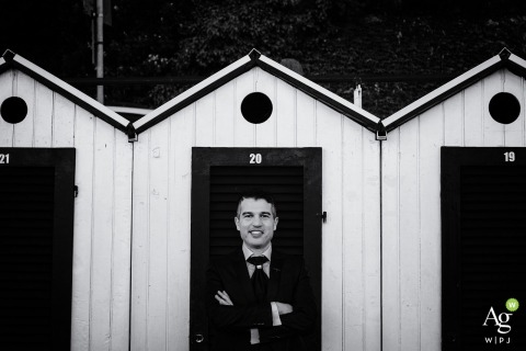 Oviglio, Italy portrait of the groom | Wedding day photography at the beach storage buildings