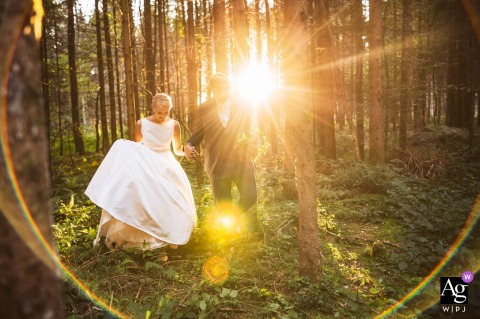 Slovenia wedding portrait In the forest | Walking towards the photographer when then is a strong sun shining trough the forest