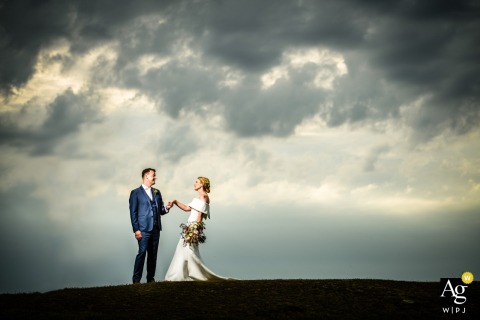 Albecq, Guernsey Couple against stormy sky | Creative wedding portraits of the bride and groom